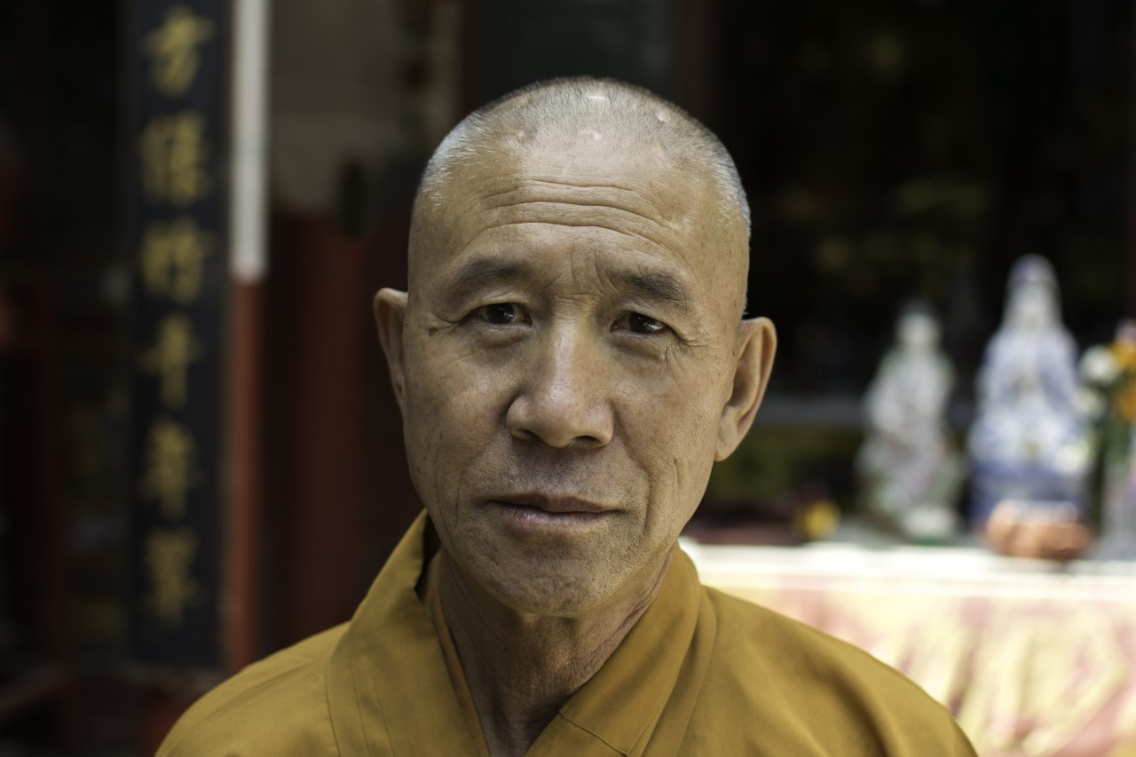 Portrait of a monk with a clean shaven head.