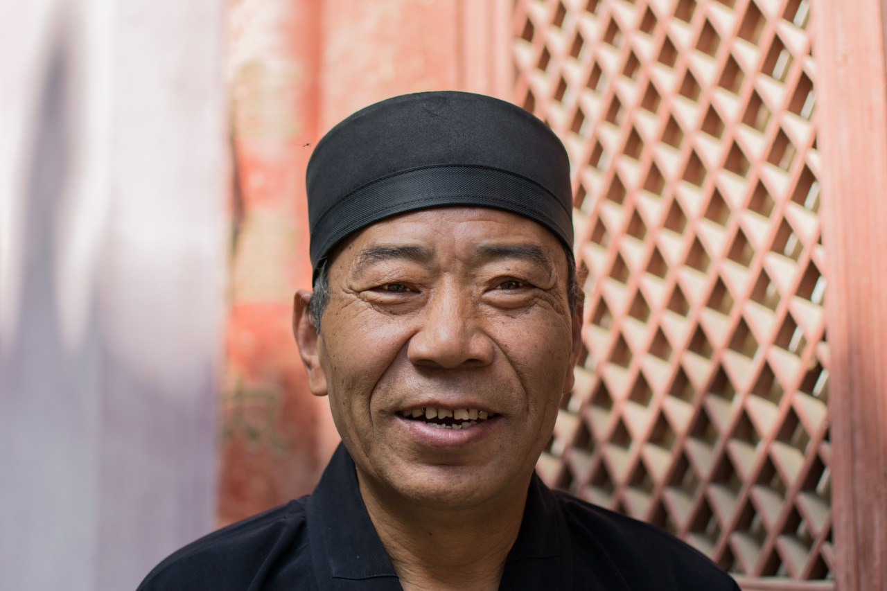 Portrait of a smiling Chinese man.