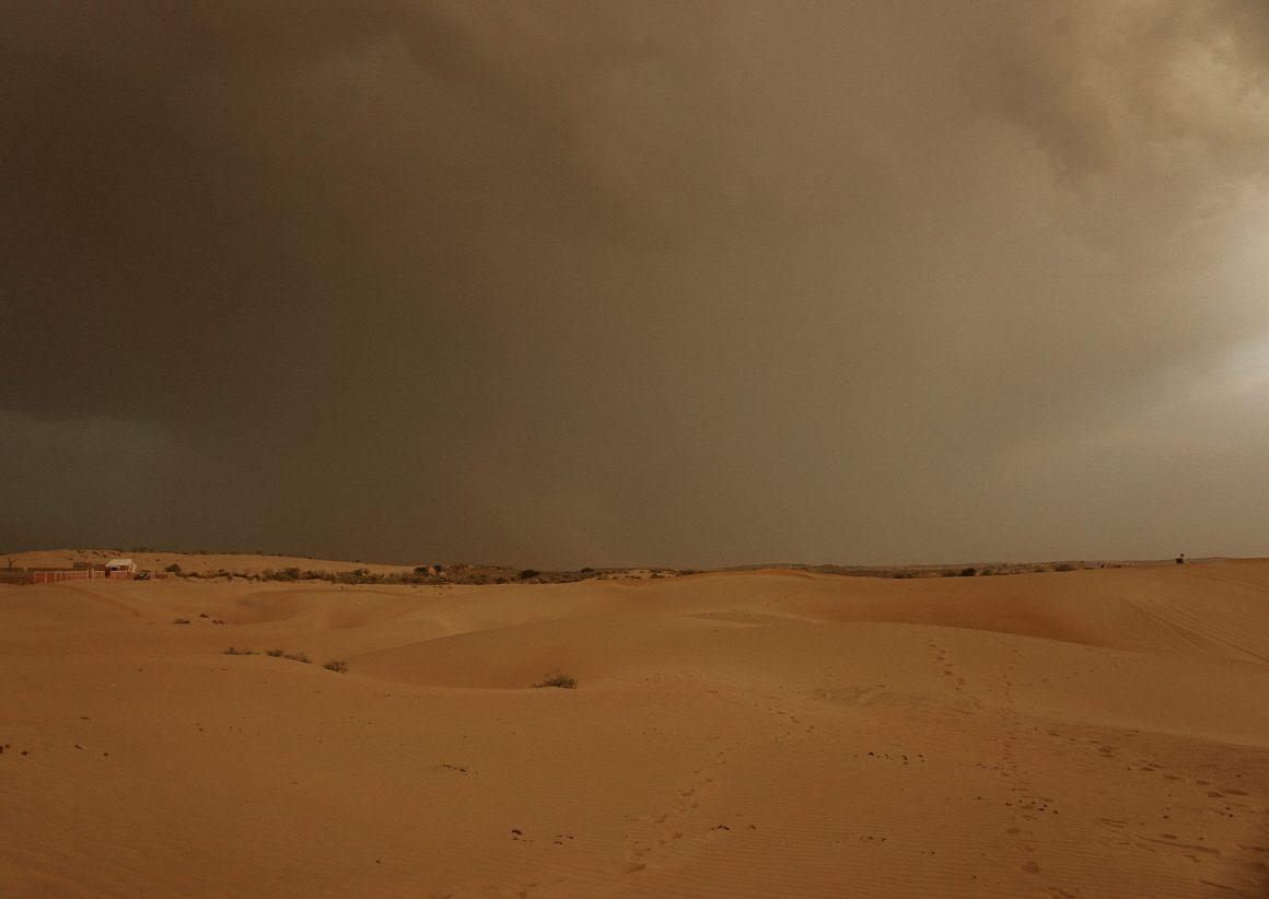 storm in desert jaislamer desert camel camping opium tea hash