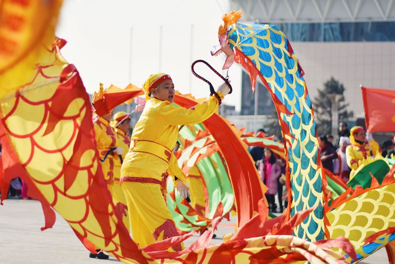 A Chinese performer performing a dragon dance during the Spring festival.